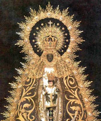 Velas blancas y celestes para la Virgen de Regla